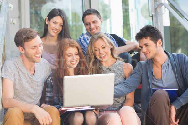 Happy students looking at laptop outside Stock photo © wavebreak_media