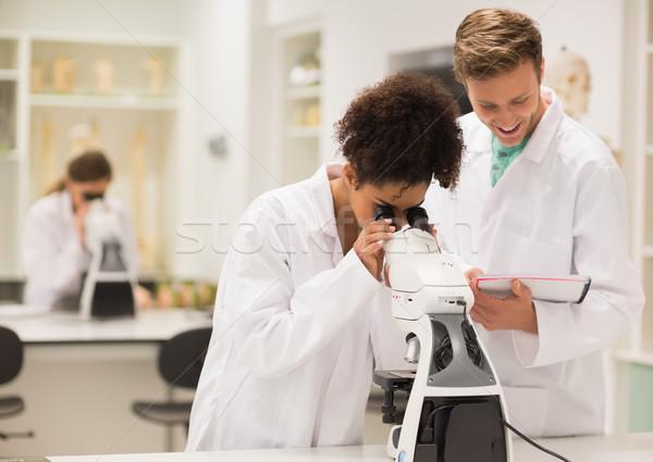 ストックフォト: 医療 · 学生 · 作業 · 顕微鏡 · 大学 · 男