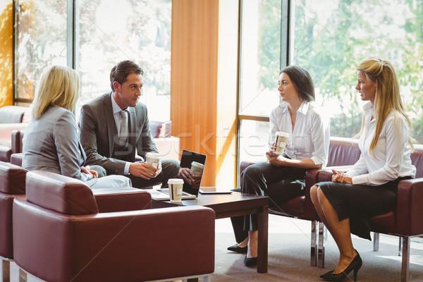 üzletemberek beszél együtt dolgozni kanapé iroda számítógép Stock fotó © wavebreak_media
