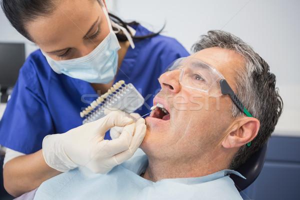 Dentist comparing teeth whitening Stock photo © wavebreak_media