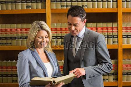 Lawyers reading book in the law library Stock photo © wavebreak_media