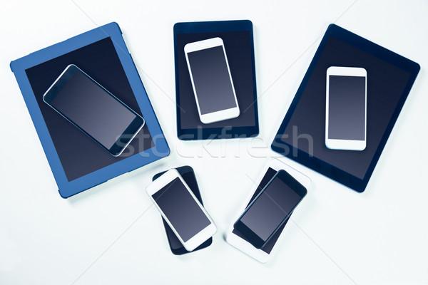 Overhead of smartphones and tablets Stock photo © wavebreak_media