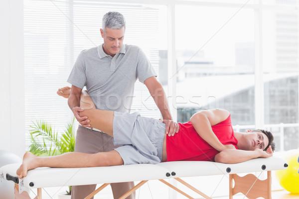 Nogi masażu pacjenta medycznych biuro człowiek Zdjęcia stock © wavebreak_media