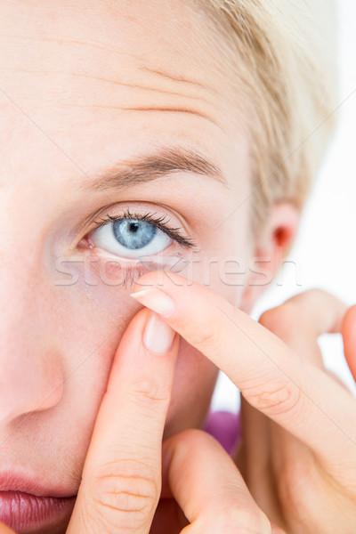 довольно блондинка контактная линза белый женщины Сток-фото © wavebreak_media