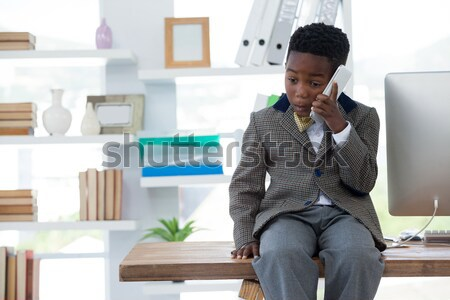 Young thinking businessman looking in the distance Stock photo © wavebreak_media