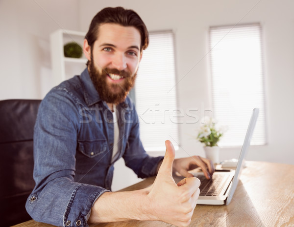 Hipster businessman showing thumbs up to camera Stock photo © wavebreak_media