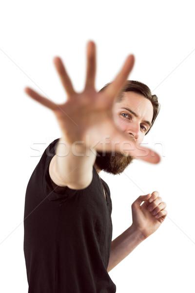 Jóképű hipszter tart kéz felfelé kamerába Stock fotó © wavebreak_media
