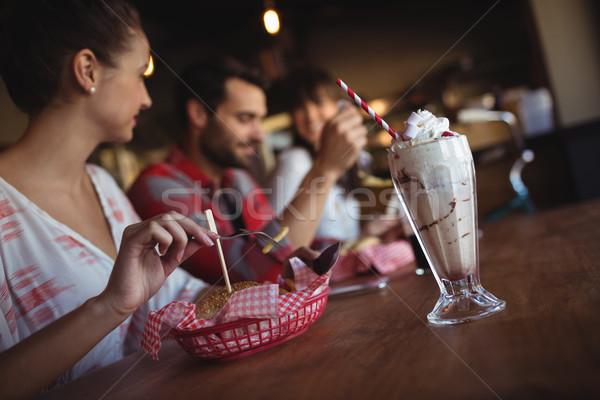 Friends having burger together Stock photo © wavebreak_media
