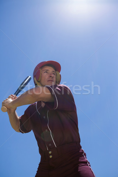 Confident player with baseball bat against  sky Stock photo © wavebreak_media