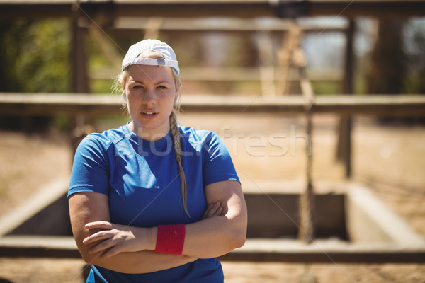 Portrait of woman standing with arms crossed during obstacle course Stock photo © wavebreak_media