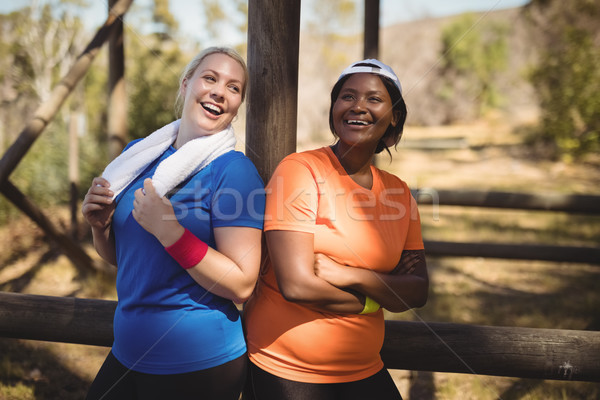 Happy friends standing with arms crossed during obstacle course Stock photo © wavebreak_media