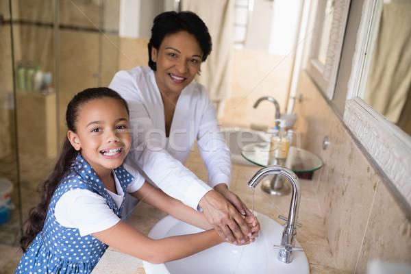 Portrait of grandmother and granddaughter washing hands Stock photo © wavebreak_media