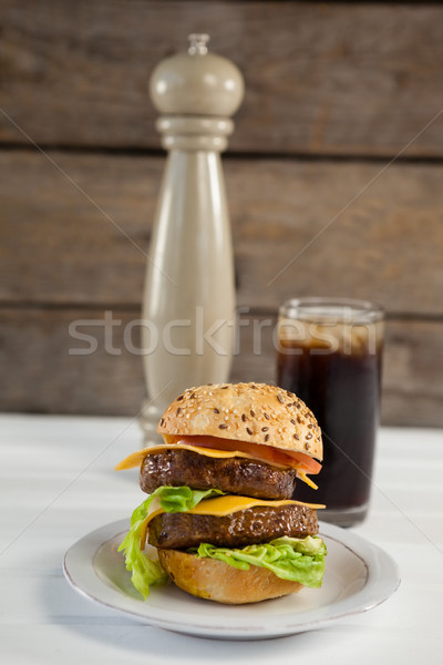 Close-up of hamburger in plate with glass of cold drink Stock photo © wavebreak_media