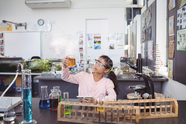 Elementary student examining liquid in beaker Stock photo © wavebreak_media