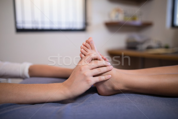 Low section of boy receiving foot massage from female therapist Stock photo © wavebreak_media