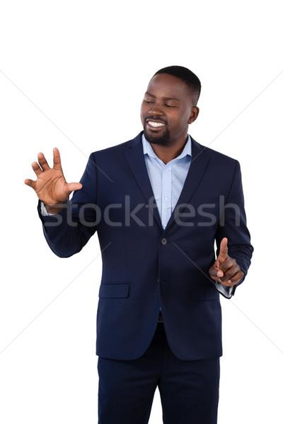 Businessman pressing an invisible virtual screen Stock photo © wavebreak_media
