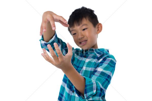 мальчика невидимый объект белый счастливым Сток-фото © wavebreak_media