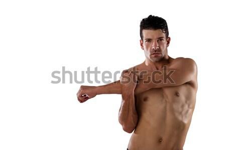 Portrait of determind shirtless player stretching hands Stock photo © wavebreak_media