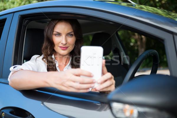 Mulher telefone móvel carro bela mulher viajar Foto stock © wavebreak_media