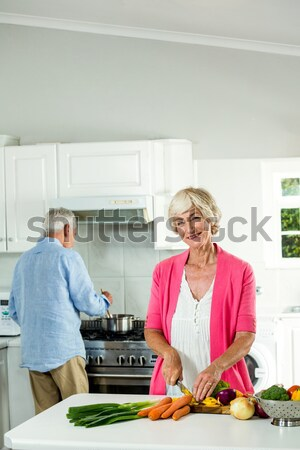 Senior couple interacting while preparing food Stock photo © wavebreak_media