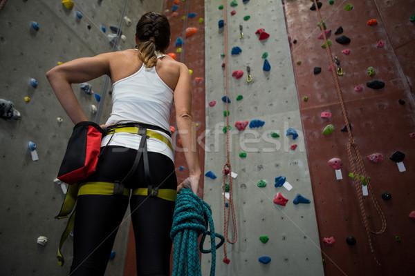 Woman standing with hand on hip in fitness studio Stock photo © wavebreak_media