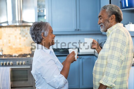 Man interacting with female doctor writing on paper in nursing home Stock photo © wavebreak_media