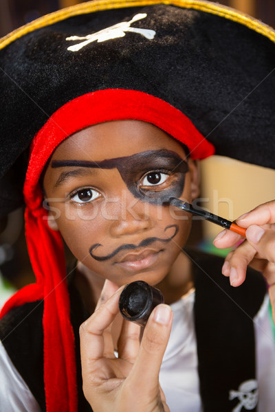 Hand of woman drawing on boy eyes Stock photo © wavebreak_media