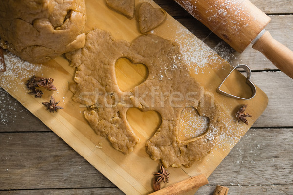 Pastry dough and pastry cutter on cutting board by rolling pin Stock photo © wavebreak_media