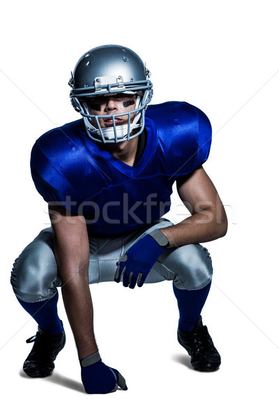 American football player in uniform crouching Stock photo © wavebreak_media