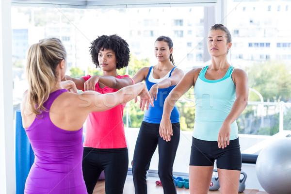 Instructor demonstrating exercise to women Stock photo © wavebreak_media
