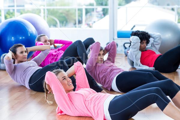 Kobiet siedzieć drewnianej podłogi fitness studio Zdjęcia stock © wavebreak_media