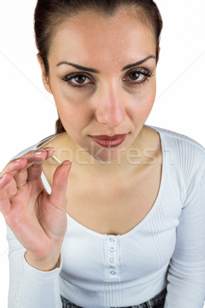 Portrait of woman holding pill  Stock photo © wavebreak_media