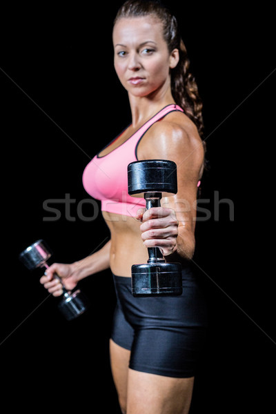Portrait side view of woman exercising with dumbbells Stock photo © wavebreak_media