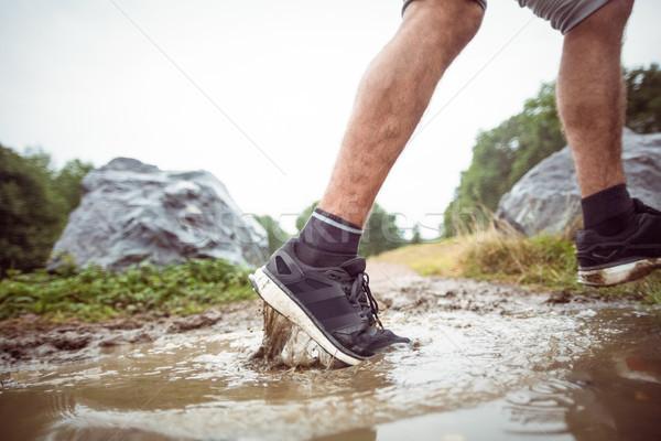 Férfi sétál sáros zöld környezet kaland Stock fotó © wavebreak_media