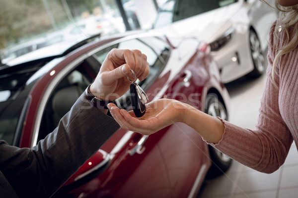 Close up of salesman giving car keys to female customer Stock photo © wavebreak_media
