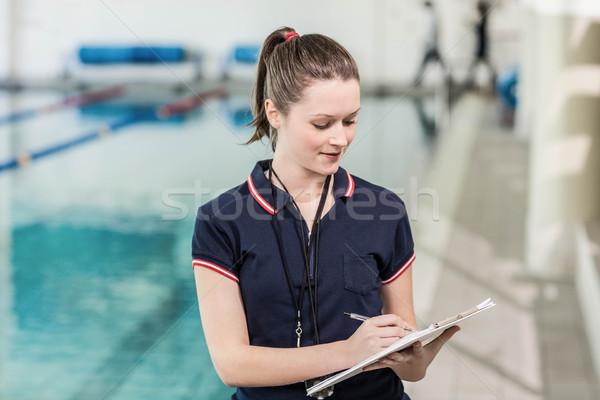 Dość trener piśmie schowek basen kobieta Zdjęcia stock © wavebreak_media