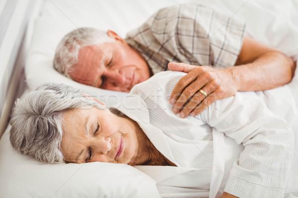 Senior couple sleeping on bed Stock photo © wavebreak_media