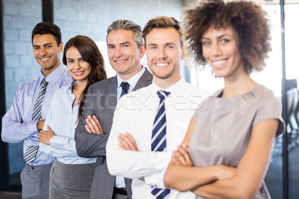 Portrait équipe commerciale bureau permanent mains affaires Photo stock © wavebreak_media