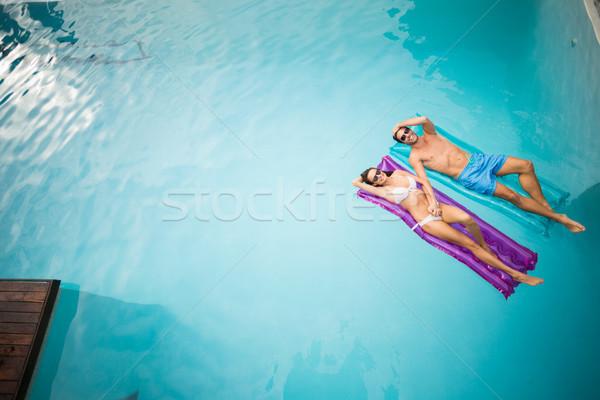 Young couple relaxing on inflatable raft Stock photo © wavebreak_media