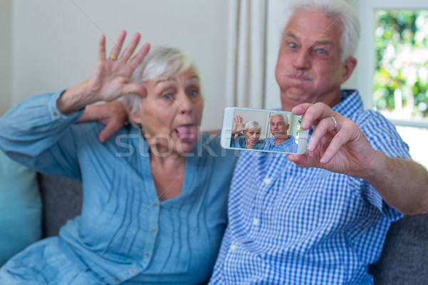 Senior couple making faces while taking selfie  Stock photo © wavebreak_media