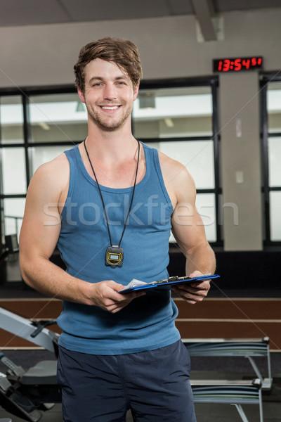 Retrato feliz gimnasio entrenador portapapeles Foto stock © wavebreak_media