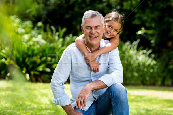 祖父 笑みを浮かべて 幸せ 少女 笑顔 愛 ストックフォト © wavebreak_media