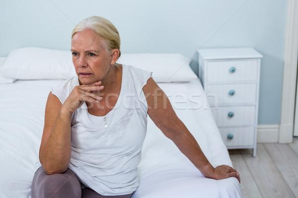 расстраивать старший женщину сидят кровать спальня Сток-фото © wavebreak_media