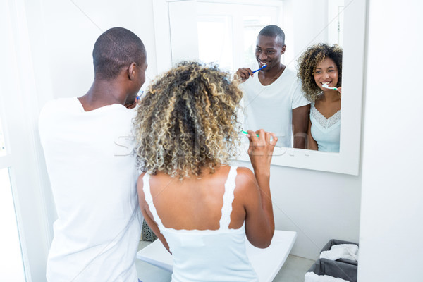 Young couple brushing their teeth at home Stock photo © wavebreak_media