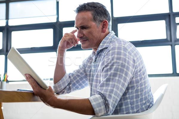 Thoughtful man looking at digital tablet Stock photo © wavebreak_media