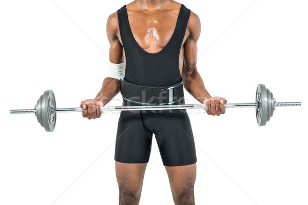 Mid-section of bodybuilder lifting heavy barbell weights Stock photo © wavebreak_media