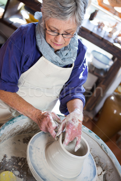 Attentive female potter making pot Stock photo © wavebreak_media