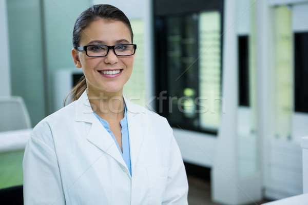 Optometrist in spectacles smiling in optical store Stock photo © wavebreak_media