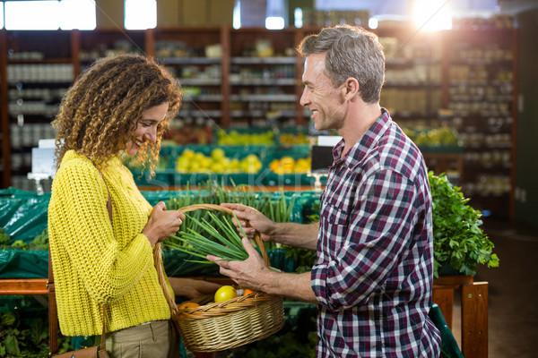 Happy couple buying vegetables in organic section Stock photo © wavebreak_media