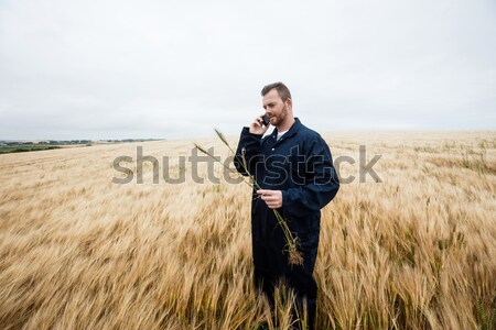 Farmer standing with arms crossed in the field Stock photo © wavebreak_media